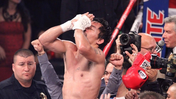Pacquiao wins to scores of 118-109, 118-109, 114-113 (Photo by Jhay Oh Otamias)
